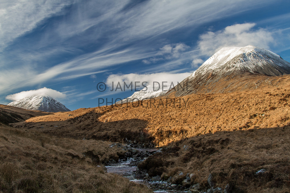 A view from a walk up the Corran River showing all 3 Paps of Jura in perfect crisp winter conditions