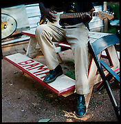 """BESSEMER, AL – OCTOBER 15, 2011: Blues legend Henry """"Gip"""" Gipson, 90, rehearses a song in preparation for a show in his backyard juke joint. <br /> <br /> After an altercation with the KKK in the 60's rendered his left hand badly broken, Gipson's method of guitar playing had to change. """"I had to crowd the strings,"""" Gipson said, describing the method that he adopted. Today, Gipson operates Gip's Place, one of few true remaining juke joints in the country. """"Music don't care no color,"""" Gipson said. """"And that's why I love blues, because blues deals with a story to tell you."""""""