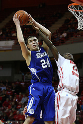 12 January 2013:  Joey King gets the rebound over Johnny Hill during an NCAA Missouri Valley Conference mens basketball game Where the Bulldogs of Drake University beat the Illinois State Redbirds 82-77 in Redbird Arena, Normal IL