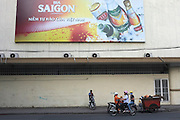 © Licensed to London News Pictures. 07/01/2012. A street scene featuring an advertising billboard for Saigon Beer in Siagon, Vietnam. Photo credit : Stephen Simpson/LNP