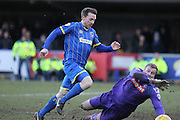 Super-Sub Davis Connolly rounds Elliot Justham to score the injury time winner during the Sky Bet League 2 match between AFC Wimbledon and Luton Town at the Cherry Red Records Stadium, Kingston, England on 21 February 2015. Photo by Stuart Butcher.
