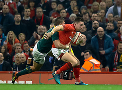 Josh Adams of Wales is tackled by Handre Pollard of South Africa<br /> <br /> Photographer Simon King/Replay Images<br /> <br /> Under Armour Series - Wales v South Africa - Saturday 24th November 2018 - Principality Stadium - Cardiff<br /> <br /> World Copyright © Replay Images . All rights reserved. info@replayimages.co.uk - http://replayimages.co.uk