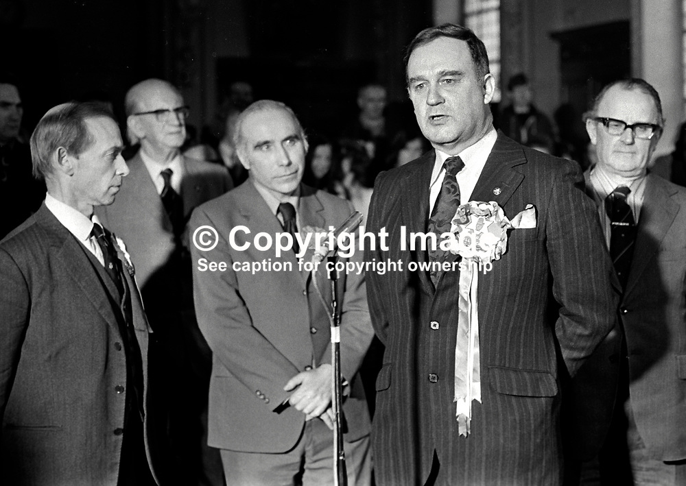 Vanguard Unionist politician, William Craig, makes victory speech, at City Hall, Belfast, N Ireland, after winning the East Belfast seat in the 28th February 1974 UK General Election. Also in the photo are Stanley McMaster, Ulster Unionist candidate, David Bleakley, N Ireland Labour Party candidate, and Des Gillespie, SDLP candidate. 197402180130k.<br /> <br /> Copyright Image from Victor Patterson, Belfast, UK<br /> <br /> t: +44 28 9066 1296 (from Rep of Ireland 048 9066 1296)<br /> m: +44 7802 353836<br /> e: victorpattersonbelfast@gmail.com<br /> <br /> www.images4media.com<br /> <br /> Please see my full Terms and Conditions of Use at https://www.images4media.com/p/terms-conditions - it is IMPORTANT that you familiarise yourself with them.<br /> <br /> Images used online incur an additional cost. This cost should be agreed in writing in advance. Online images must be visibly watermarked i.e. © Victor Patterson or that of the named photographer within the body of the image. The original metadata must not be deleted from images used online.<br /> <br /> This image is only available for the use of the download recipient i.e. television station, newspaper, magazine, book publisher, etc, and must not be passed on to a third party. It is also downloaded on condition that each and every usage is notified within 7 days to victorpattersonbelfast@gmail.com.<br /> <br /> The right of Victor Patterson (or the named photographer) to be identified as the author is asserted in accordance with The Copyright Designs And Patents Act (1988). All moral rights are asserted.
