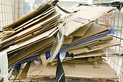 Piles of flatten cardboard boxes at a supermarket; ready for recycling,