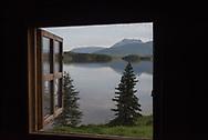 A cabin window on the North Arm of Naknek Lake, Alaska