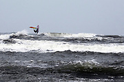 © Licensed to London News Pictures. 16/02/2016. Anglesey, UK Windsurfers and kitesurfers brave heavy winds and high waves  at Rhosneigr Beach in Anglesey today 16th February 2016. Photo credit : Stephen Simpson/LNP
