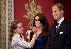 © London News Pictures. 04/04/2012. London, UK. Madame Tussauds employee Rebecca Holmes puts the finishing touches to wax work figures of The Duke and Duchess of Cambridge, CATHERINE (KATE) MIDDLETON and PRINCE WILLIAM at their unveiling at Madame Tussauds in London on April 4, 2012. The couple are portrayed in their engagement pose. Photo credit : Ben Cawthra/LNP