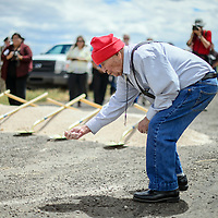 082014       Adron Gardner<br /> <br /> Senator John Pinto spreads dust after a blessing for the groundbreaking of expanded U.S. Highway 491 road  construction in Twin Lakes Wednesday.