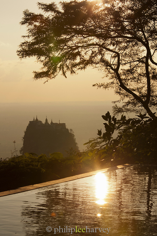 Taung Kalat Buddhist monastery perched on a volcanic plug near Mount Popa, seen here from a luxury hotel. Near the ancient city of Bagan, Myanmar