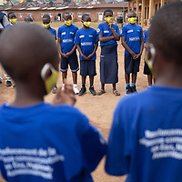 At a school in Butembo, Congo, a Tearfund leader speaks with one of several groups of students in the school who have been specially trained in healthcare and the prevention and control of infection. IMA and Tearfund worked together on the project in the framework of a broad programme to strengthen response and recovery to Ebola in North Kivu.