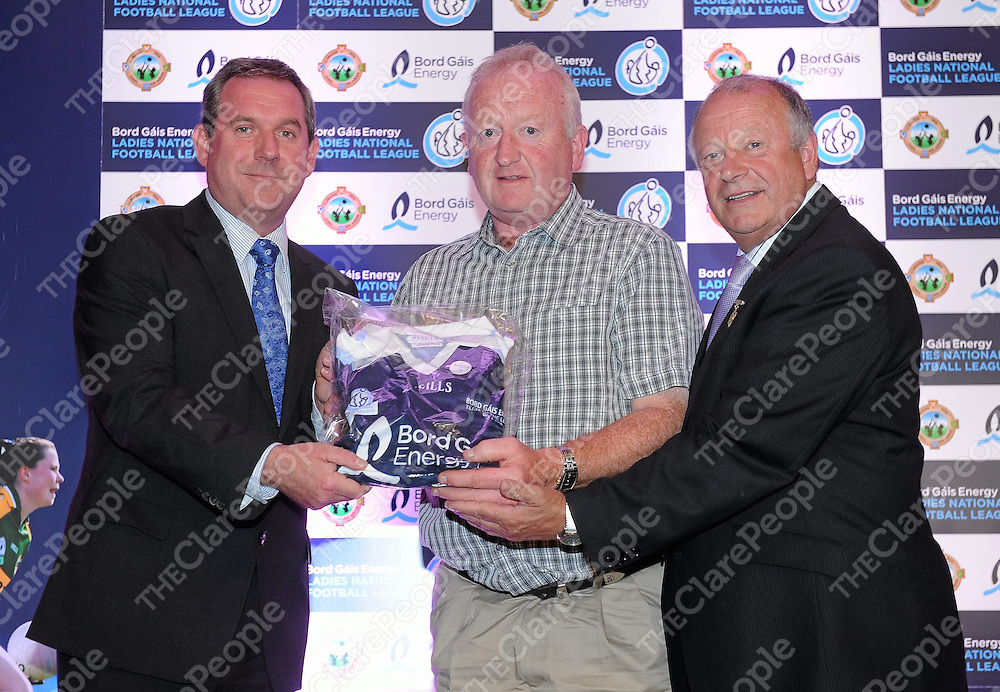 26 May 2010; Johnny Hayes, Chairman of the Clare County Ladies Football Board, on behalf of Clare footballer Lorraine Kelly, receives her award for making the Division 2 Team of the League from Nicky Doran, left, Head of Marketing, Bord Gais Energy and Pat Quill, President, Cumann Peil Gael na mBan, at the announcement of the Bord Gais Energy Teams of the 2010 Leagues. This is the second year of the joint initiative from the Ladies Gaelic Football Association and Bord Gáis Energy which recognises the players who excelled during the league campaigns across all four divisions. 60 players from 28 counties were selected and were presented with a specially commissioned kit to mark their achievements. Croke Park, Dublin. Picture credit: Brendan Moran / SPORTSFILE *** NO REPRODUCTION FEE ***