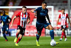 Jonson Clarke-Harris of Bristol Rovers takes on Joe Morrell of Lincoln City - Mandatory by-line: Robbie Stephenson/JMP - 14/09/2019 - FOOTBALL - Sincil Bank Stadium - Lincoln, England - Lincoln City v Bristol Rovers - Sky Bet League One