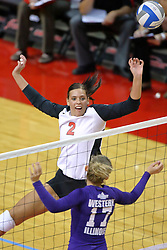 07 September 2011: Leighann Hranka soft taps the ball over the net and past Sarah Fetter during an NCAA volleyball match between the Leathernecks of Western Illinois  and the Illinois State Redbirds at Redbird Arena in Normal Illinois.