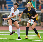 Edwardsville forward Brynn Miracle (left) kicks the ball past OFallon midfielder Kiley McMinn. OFallon defeated Edwardsville in a girls soccer playoff game at OFallon High School in OFallon, IL on Tuesday June 8, 2021. <br /> Tim Vizer/Special to STLhighschoolsports.com.
