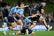 Luke Jacobson of the Chiefs is tackled by Hugh Sinclair of the Waratahs during the Round 5 Trans-Tasman Super Rugby match between NSW Waratahs and Waikato Chiefs at Brookvale Oval in Sydney, Saturday, June 12, 2021. (AAP Image/Dan Himbrechts) NO ARCHIVING, EDITORIAL USE ONLY
