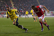 Middlesbrough midfielder Emilio Nsue (24)  gets away from Rotherham United defender Joe Mattock (3)  during the Sky Bet Championship match between Rotherham United and Middlesbrough at the New York Stadium, Rotherham, England on 8 March 2016. Photo by Simon Davies.
