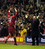 Photo. Jed Wee.<br /> Liverpool v Levski Sofia, UEFA Cup, Anfield, Liverpool. 26/02/2004.<br /> Liverpool goalscorer Steven Gerrard (L) makes a beeline for under fire manager Gerard Houllier to celebrate.