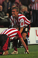 Photo: Tony Oudot.<br /> <br /> Brentford v Lincoln City. Coca Cola League 2. 27/10/2007.<br /> <br /> Sammy Moore of Brentford celebrates his winning goal with team mate Craig Pead in style
