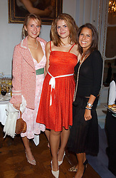Left to right, GRACE HUGHES-HALLETT, STELLA POWELL-JONES daughter of Flora Fraser and NATASHA LEONARD at a party to celebrate the publication of 'Princesses' the six daughters of George 111 by Flora Fraser held at the Saville Club, Brook Street, London W1 on 14th September 2004.<br />