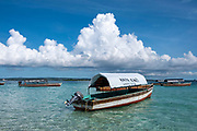 Tourist taxi boats wait in the shallow waters off Changuu island, also known as prison island,  Zanzibar, Tanzania.  Tourists visit prison Island on a daily basis from Stone Town, Zanzibar.  (photo by Andrew Aitchison / In pictures via Getty Images)