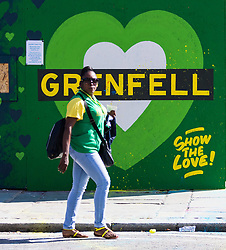London, August 27 2017. The victims of the Grenfell Tower disaster will be remembered with a minute's silence at sunset as Family Day of the Notting Hill Carnival gets underway. The Notting Hill Carnival is Europe's biggest street party held over two days of the bank holiday weekend, attracting over a million people. © Paul Davey.