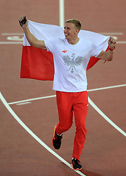 Poland's Piotr Lisek celebrates silver in the Men's Pole Vault during day five of the 2017 IAAF World Championships at the London Stadium.