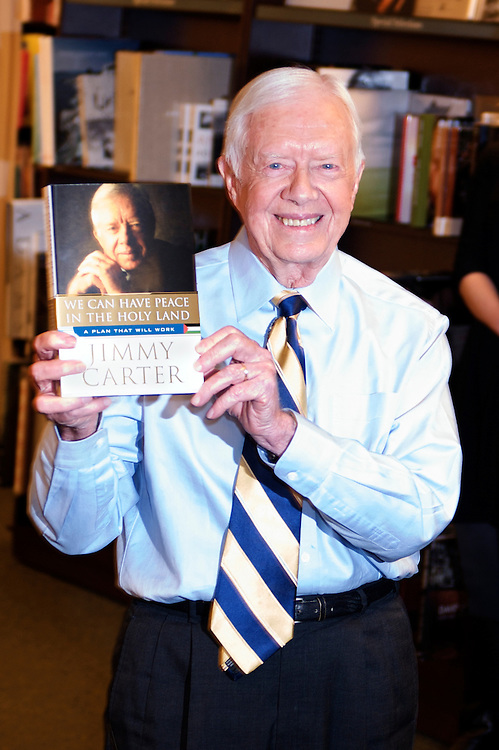 Former President Jimmy Carter with his book 'We Can Have Peace in the Holy Land' in New York City.