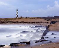 AA05849-01...NORTH CAROLINA - Waves hitting the jetty at Cape Hatteras; Cape Hatteras National Seashore.