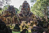 Ta Som was built at the end of the 12th century for King Jayavarman VII. It is just east of Neak Pean. The King dedicated the temple to his father Dharanindravarman II who was King from 1150 to 1160. The temple consists of a single shrine located on one level and surrounded by walls. Like the nearby Preah Khan and Ta Prohm the temple was left largely unrestored, with numerous trees and other vegetation growing among the ruins. In 1998, the World Monuments Fund added the temple to their restoration program and began work to stabilise the structure to make it safer for visitors. Ta Som is surrounded by a moat.