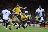 Australia's Will Genia © and Adam Ashley-Cooper attempt to collect a loose ball only to be denied by a strong Fiji tackle. Rugby World Cup 2015 pool A match, Australia v Fiji at the Millennium Stadium in Cardiff, South Wales  on Wednesday 23rd September 2015.<br /> pic by  Andrew Orchard, Andrew Orchard sports photography.