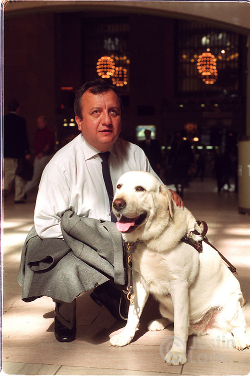Portraits of Omar Rivera and his seeing eye dog, Salty. Rivera was working on the 71st flr of the World trade Tower 1 when the attack began on Sep 11, 2001. He was saved by his dog. he was photographed at Grand central Station..JUSTIN LANE FOR THE NEW YORK TIMES