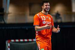 The Dutch handball player Samir Benghanem in action during the European Championship qualifying match against Turkey in the Topsport Center Almere.
