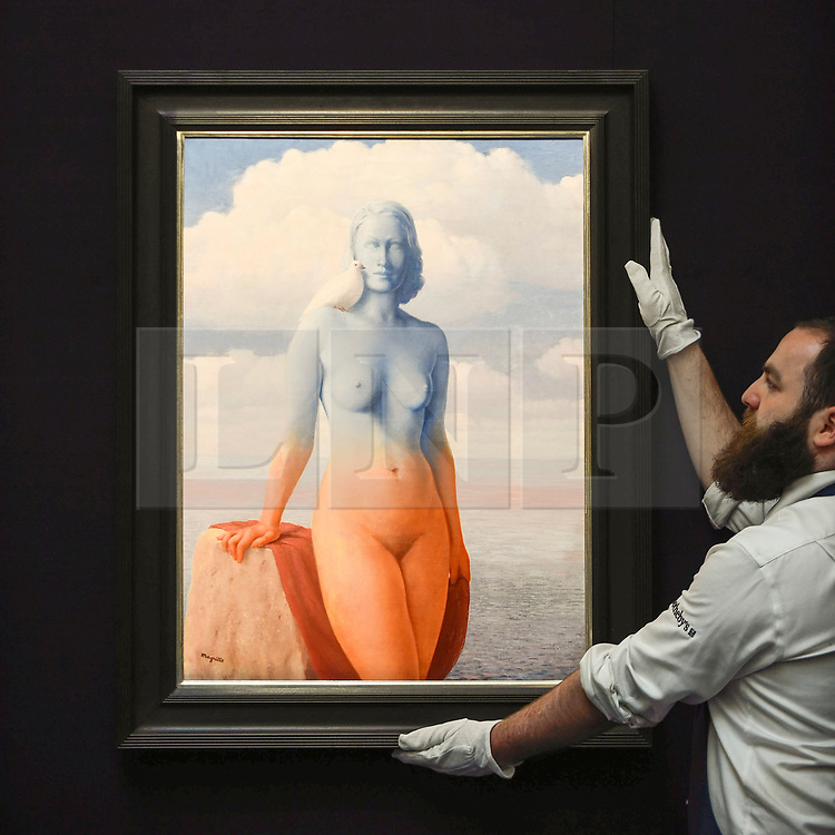 """© Licensed to London News Pictures. 14/06/2019. LONDON, UK. A technician presents """"La magie noire"""", 1946, by René Magritte (Est. £2.5-3.5m). Preview of Impressionist and Modern art sales, which will take place at Sotheby's New Bond Street on 18 and 19 June 2019. Photo credit: Stephen Chung/LNP"""