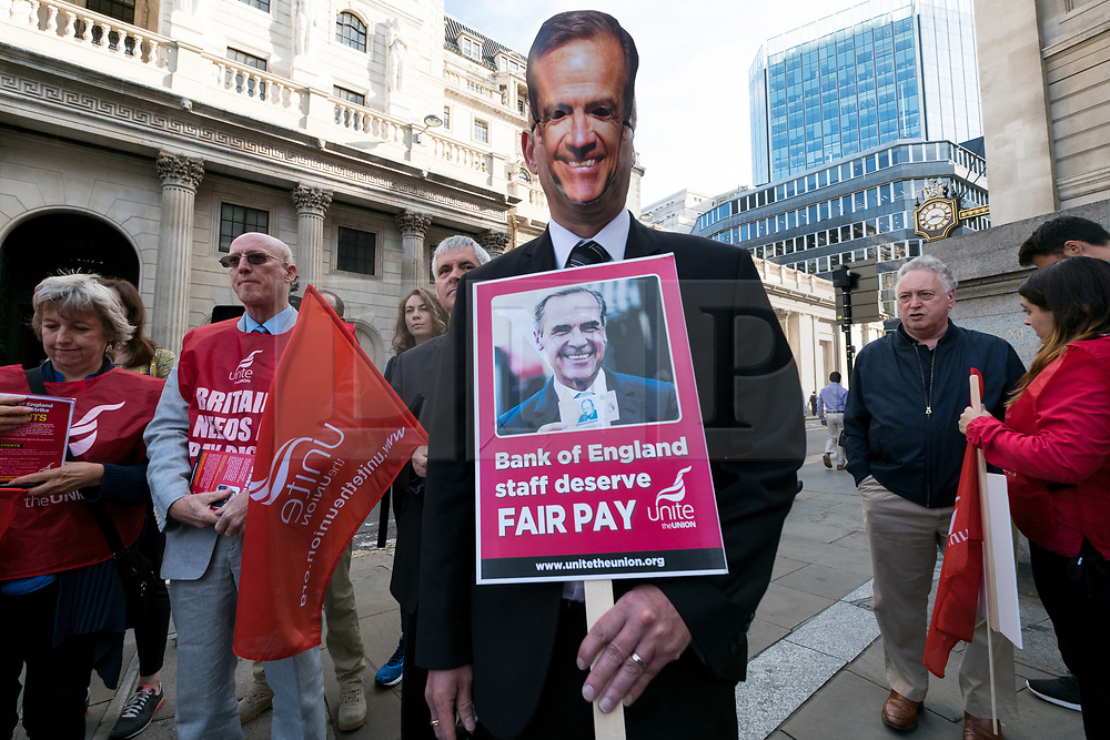 © Licensed to London News Pictures. 01/08/2017. London, UK. Members of Unite trade union wearing masks of Mark Carney, governor of the Bank of England, hold a demonstration outside the Bank of England   The strike is the first strike at the iconic bank in over 50 years due to being offered a below inflation pay offer. Photo credit: Ray Tang/LNP