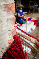 """Preparation of materials for conical hat making process, Chuong Village, Ha Tay Province, Vietnam, Southeast Asia, 2013. This handicraft village specializes in the fabrication of the conical hat, known as """"non"""" in Vietnamese."""