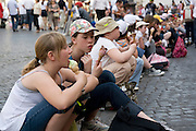 Italy, Rome, Piazza Navona Tourists enjoy a break and eat ice cream