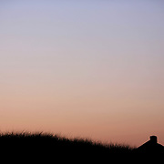 Beachside properties at sunset on the coastline at Cisco Beach, Nantucket, Nantucket Island, Massachusetts, USA. Photo Tim Clayton