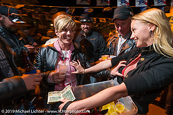 Kristi Verhoff serves up shots at the Boot Hill Saloon on Main Street during Daytona Bike Week. FL, USA. March 13, 2014.  Photography ©2014 Michael Lichter.