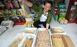 Sun Hui, a dealer, shows ginseng-related products in Ji'an, northeast China's Jilin Province, June 11, 2015. China has a long history of cultivating ginseng, which is considered to be nutritious and to have medicinal value in traditional Chinese medicine. Considered as the world's largest ginseng production area, Jilin produces about 85 percent of China's total ginseng output and 70 percent of the world's output. More than 98 percent of ginseng in Jilin is currently cultivated, not grown in the wild. EXPA Pictures © 2015, PhotoCredit: EXPA/ Photoshot/ Wang Haofei<br /> <br /> *****ATTENTION - for AUT, SLO, CRO, SRB, BIH, MAZ only*****