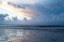© Licensed to London News Pictures. 01/02/2014. Titchfield, Hampshire, UK. Dawn as storm clouds pass in the distance on what is set to be another stormy day, with more wet and windy weather forecast. Photo credit : Rob Arnold/LNP