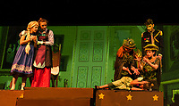 """Little Elsa (Sydney Eastman), Queen Iduna (Allie Kenyon) and King Agnarr (John Blandford) watch as the Troll Queens Bulda (Savannah Neuman) and Pabbie (Mark Uicker) work over Little Anna (Anna Coapland) during dress rehearsal for """"Frozen"""" with Gilford Middle School on Wednesday.  (Karen Bobotas/for the Laconia Daily Sun)"""
