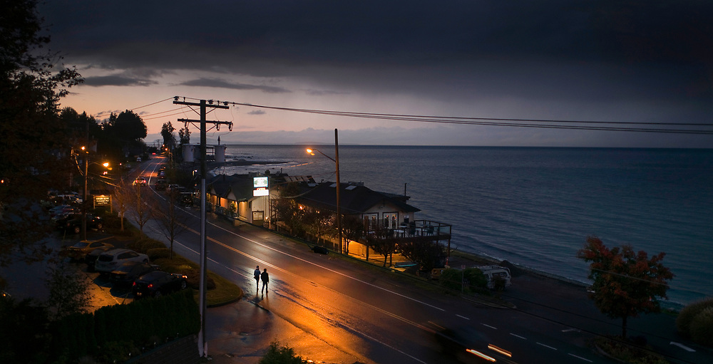 People head to a local Pub on a Friday night in Qualicum Beach, BC. (2016)