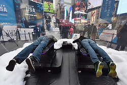 (L-R) Ed Baily and Heidi Baily ride the Skeleton Virtual Reality simulator during the Team USA Winter Fest  - 100 day countdown to the 2018 Winter Olympics, in Times Square, New York, on November 1, 2017. (Photo by Anthony Behar/Sipa USA)