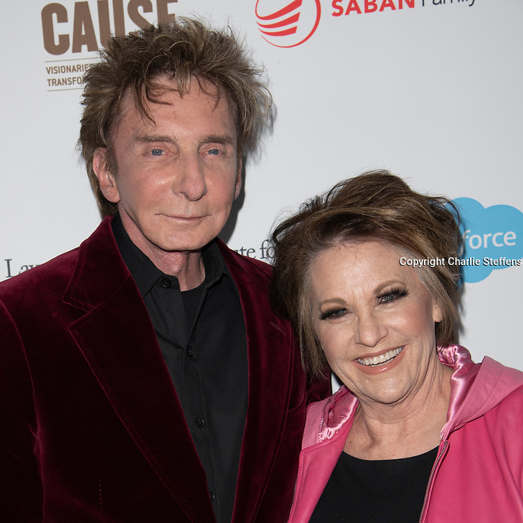 BARRY MANILOW and LORNA LUFT attend the 'Rebels With A Cause'  benefitting the Lawrence J. Ellison Institute for Transformative Medicine of USC at The Water Garden in Santa Monica, California.