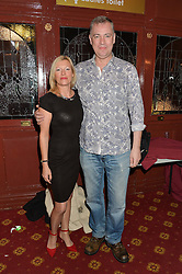 MATTHEW RIXON and his wife KATY at the opening night of Cinderella at The New Wimbledon Theatre, 93 The Broadway, London SW19 1QG on 9th December 2014.