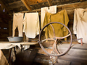 """An 1890s era laundry building is restored in Nevada City, Montana, USA. In 1870, Chinese people (nearly all male) made up 10% of the territorial population of Montana. Territorial laws prohibited """"China Men"""" from owning placer claims, so they mined the leavings of others or performed laundry or domestic service, which was always in great demand. Today, Nevada City contains several fascinating Chinese buildings built about 1890, mostly moved here from Butte, Montana. Nevada City was a booming placer gold mining camp from 1863-1876, but quickly declined into a virtual ghost town. This fascinating town inspires you to imagination what life must have been like in early Montana when gold was discovered at nearby Alder Gulch. More than 90 buildings from across Montana have been gathered for preservation at Nevada City, mostly owned by the people of the State of Montana, and managed by the Montana Heritage Commission. In 2001, the excellent PBS television series """"Frontier House"""" used one of the buildings and its furnishings to train families in re-creating pioneer life. A miner's court trial and hanging of George Ives in the main street of Nevada City was the catalyst for forming the Vigilantes, a group of citizens famous for taking justice into their own hands in 1863-1864. Directions: go 27 miles southeast of Twin Bridges, Montana on Highway 287."""