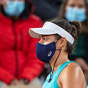 PARIS, FRANCE October 02. Caroline Garcia of France wearing a mask during a break between sets during her match against Elise Mertens of Belgium in the third round of the singles competition on Court Philippe-Chatrier during the French Open Tennis Tournament at Roland Garros on October 2nd 2020 in Paris, France. (Photo by Tim Clayton/Corbis via Getty Images)