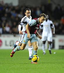 West Ham United's Mark Noble battles for the ball with Swansea City's Leon Britton  - Photo mandatory by-line: Joe Meredith/JMP - Tel: Mobile: 07966 386802 27/10/2013 - SPORT - FOOTBALL - Liberty Stadium - Swansea - Swansea City v West Ham United - Barclays Premier League