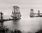 Forth Railway Bridge from the South-East, c1890, Scotland.  Completing the first bay. This bridge, built for the North British Railway Company, was begun in 1882 and opened on 4 March 1890. Benjamin Baker (1840-1907)  the engineer. William Arrol (1839-1913) the principal contractor. The steel for the girders was produced the by the Siemens-Martin process. Photograph.