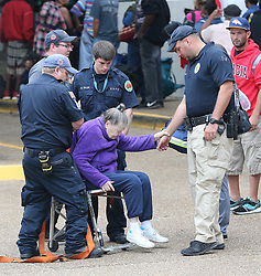 Medical personel assist a elderly woman joining hundreds of other local residents being evacuated from the city at the Savannah Civic Center during a mandatory evacuation for Hurricane Irma on Saturday, September 9, 2017, in Savannah, Ga. Officials are expecting 1,500 to 3,000 without transportation to leave by buses that are being provided. Photo by Curtis Compton/Atlanta Journal-Constitution/TNS/ABACAPRESS.COM
